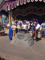 Hannah showing her strength by pulling the sword out of the stone