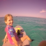 On the front of the paddle board with Uncle Ed to go snorkelling.