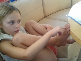 Maths lesson - catching Hannah using her toes as aid to more complicated sums!