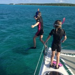 Hannah gets the courage to jump off the front of the boat.