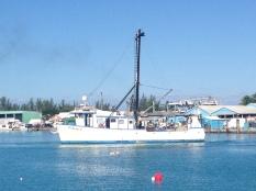 Fishing boat leaving harbour.