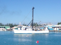 Fishing boat leaving harbour.