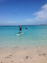 Ed getting to shore on the paddle board.