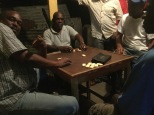 The locals playing dominoes.